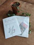 Bloemenzaden met kaart 'Fijne feestdagen kerstboom' verpakt in pergamijn zakje_