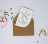 Bloemenzaden met kaart 'Een bloeiend nieuwjaar' verpakt in pergamijn zakje_