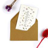 Bloemenzaden met kaart 'Gefeliciteerd' verpakt in pergamijn zakje_
