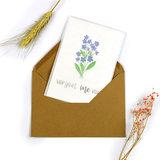 Bloemenzaden met kaart 'Vergeet me niet' verpakt in pergamijn zakje_