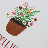 Bloemenzaden met kaart 'vrolijk pasen' verpakt in pergamijn zakje_