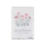 Ingepakt pergamijn zakje met zomerbloemen zadenmengsel