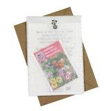 Bloemenzaden met kaart 'Een tuin planten is denken aan morgen' verpakt in pergamijn zakje_