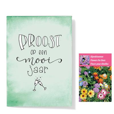 Bloemenzaden met kaart 'proost op een mooi jaar' verpakt in pergamijn zakje