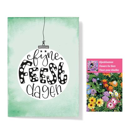 Bloemenzaden met kaart 'fijne feestdagen kerstbal' verpakt in pergamijn zakje