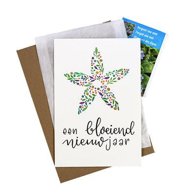 Bloemenzaden met kaart 'Een bloeiend nieuwjaar' verpakt in pergamijn zakje
