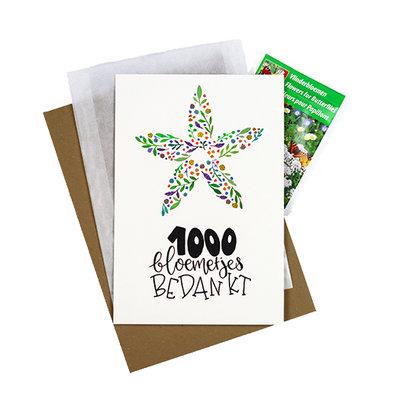 Bloemenzaden met kaart '1000 bloemetjes bedankt' verpakt in pergamijn zakje