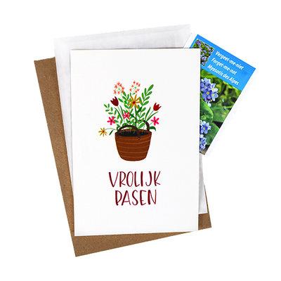 Bloemenzaden met kaart 'vrolijk pasen' verpakt in pergamijn zakje