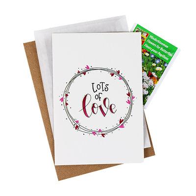 Bloemenzaden met kaart 'lots of love' verpakt in pergamijn zakje
