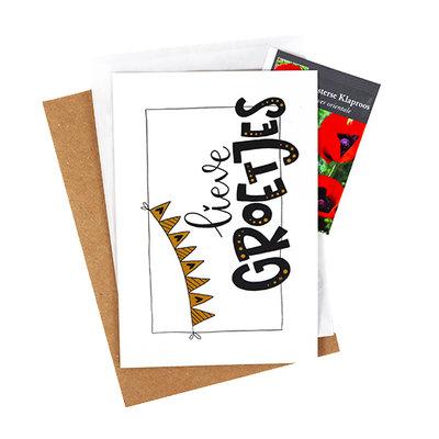 Bloemenzaden met kaart 'lieve groetjes' verpakt in pergamijn zakje