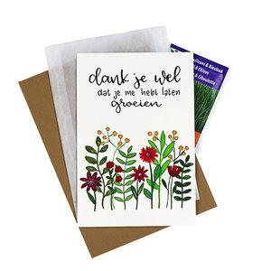 Bloemenzaden met kaart 'Dankjewel dat je me hebt laten groeien' verpakt in pergamijn zakje