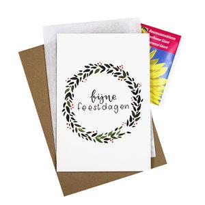 Bloemenzaden met kaart 'Fijne feestdagen' verpakt in pergamijn zakje