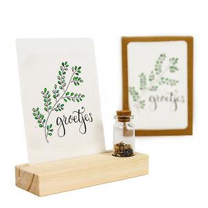 Groetjes - Bedankje zaden in glazen flesje met kaart en standaard