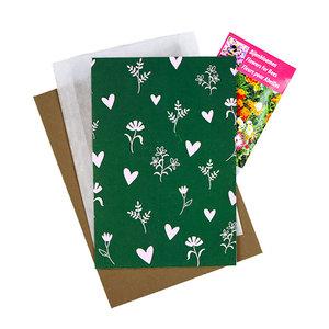 Bloemenzaden met kaart 'bloemetjes en hartjes' verpakt in pergamijn zakje