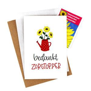 Bloemenzaden met kaart 'Bedankt zorgtopper' verpakt in pergamijn zakje